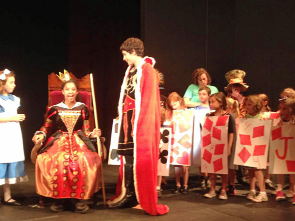 Students at the Camellot Academy rehearse Alice in Wonderland, Jr., at Rockhurst High School. The performance is Friday.