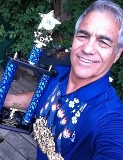 "Rich Talavera with his ""Top Overall Performer"" trophy — and a bunch of gold medals."