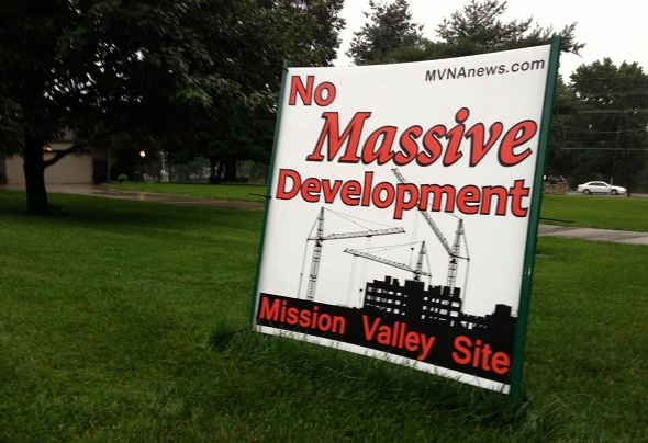 Signs protesting the proposed Mission Chateau development line the streets surrounding the Mission Valley site.