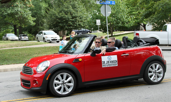 Shawnee Mission superintendent Jim Hinson made his inaugural appearance in the parade — in a stylish Mini Cooper convertible, no less.