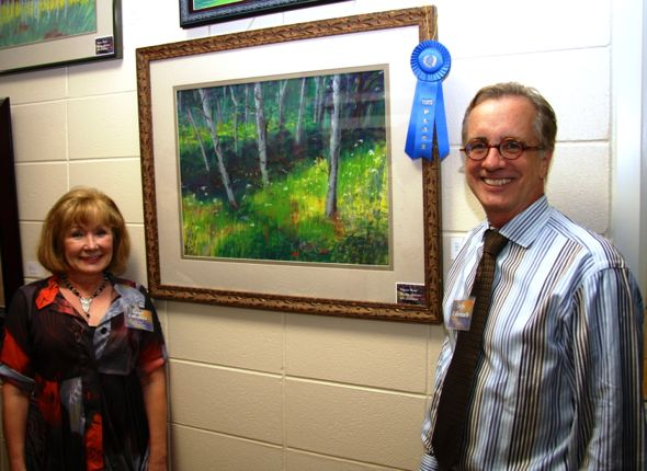 Artist Dr. John Callenbach and his wife, Largo Leslie Callenbach, with the first place painting.