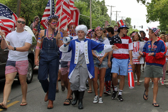"StuCo president Morgan Twibell, dressed as...George Washington?...led the ""USA"" contingent at the back of the parade pack."