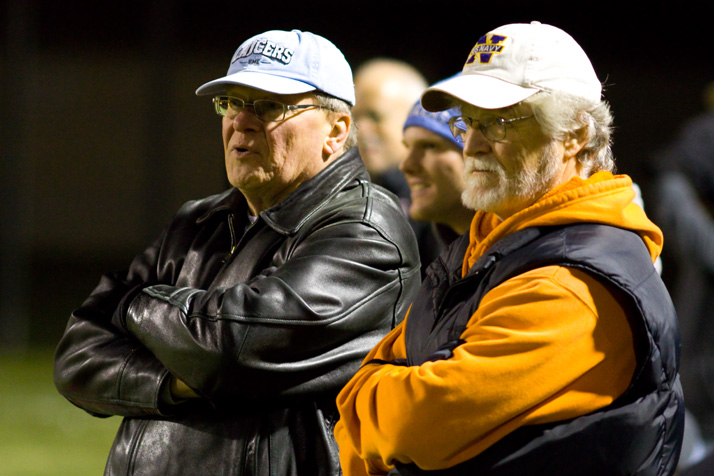 Retired SM East principal Karl Krawitz (in blue cap), who suffered a stroke in July, was on the sidelines cheering the Lancers.