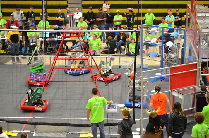 Robots maneuver at one end of the arena during the Cow Town ThrowDown.