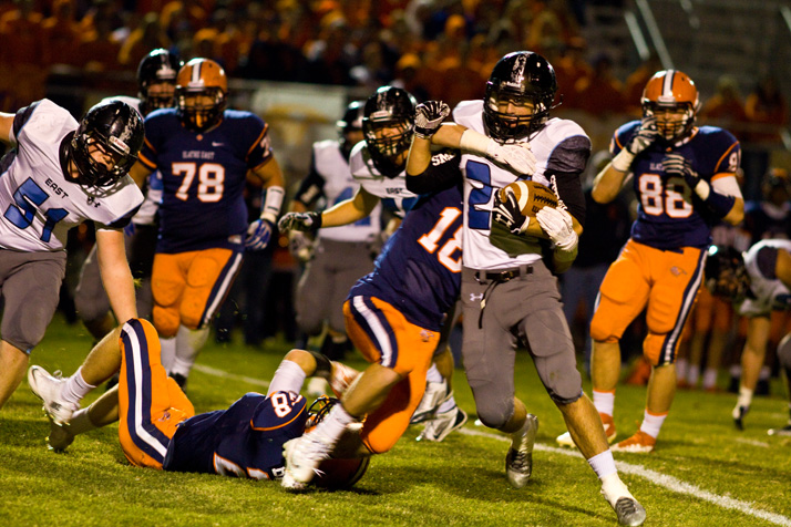 """A """"grind-it-out"""" running game helped the Lancers control the clock and limit Olathe East's opportunities on offense."""