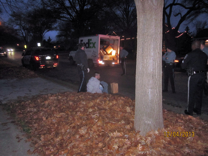 Prairie Village police inspected the stolen FedEx truck after the chase came to an end near 71st and Belinder Wednesday night. Photo submitted by reader Toby Fritz.