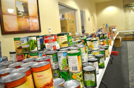 Tables were filled with canned goods waiting to be packaged.