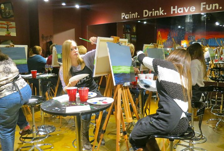 A recent group painting event at the Pinot's Palette location in Leawood. (Photo via Pinot's Palette Facebook page).