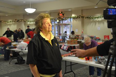 Mission councilor Suzie Gibbs who chairs the holiday gift drive was the center of attention Friday morning.