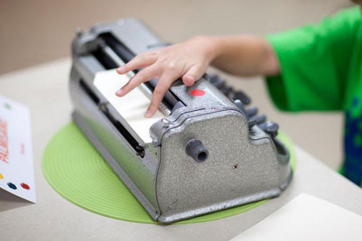 Photo via the Braille Institute.