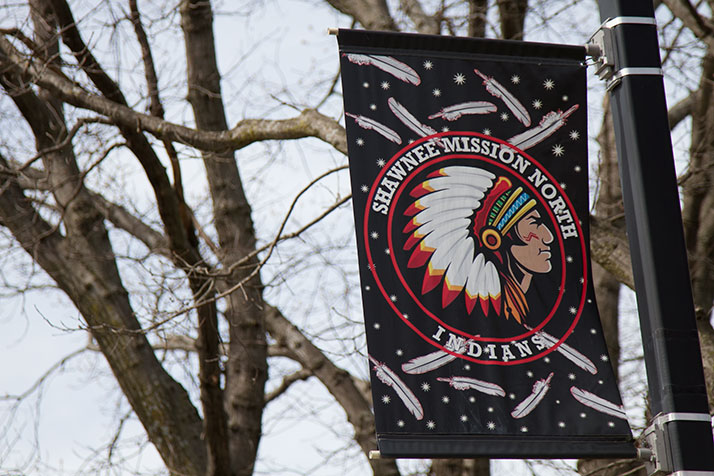 A sign showing the Shawnee Mission North High School Indian mascot