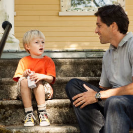 CASA volunteer speaks with young child