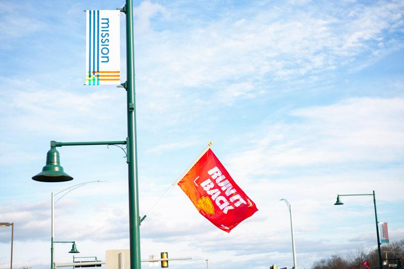 Run It Back flags on Johnson Drive light poles
