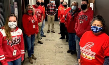 Overland Park public works staff in Chiefs gear