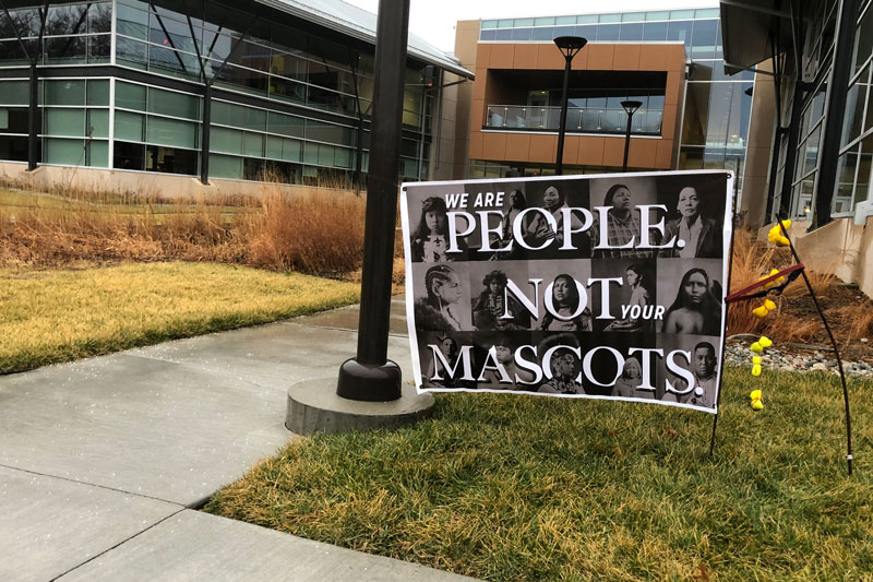 People are not mascots sign in front of Center for Academic Achievement