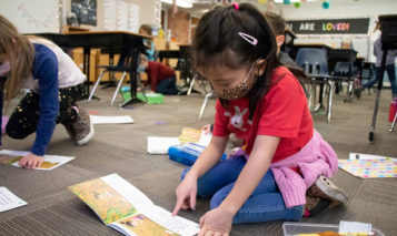 Early education students read books