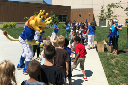Ada Wallace with students and the Royals mascot
