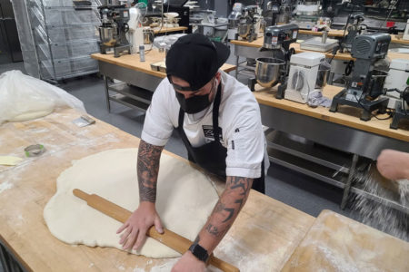 Justin Hoffman rolling dough