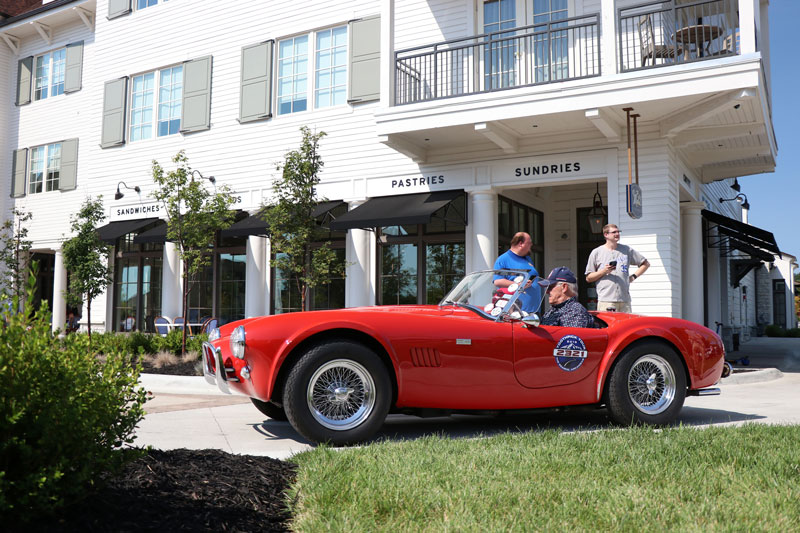A red car sits in front of The Inn at Meadowbrook