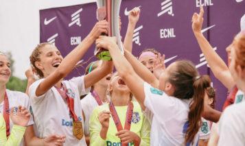 KC Athletics celebrates with trophy