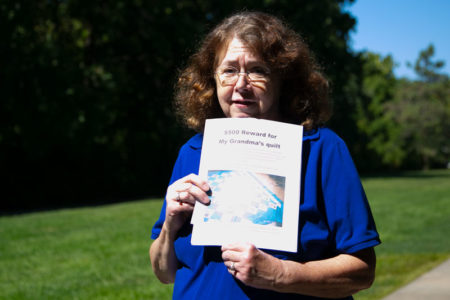 Diana Reese holds flyer