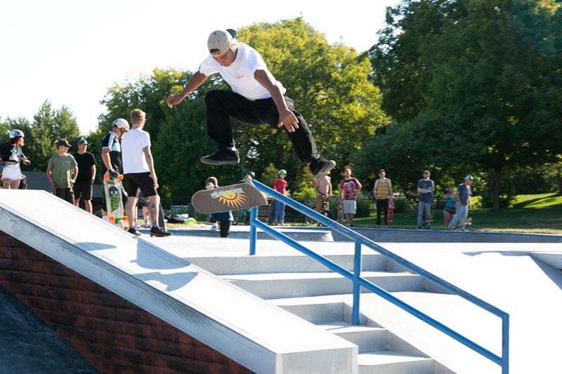 Skater glides over steps